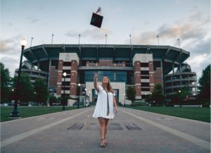 College Graduate throwing mortar board in the air