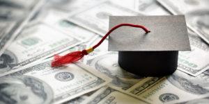 Graduation hat on top of money
